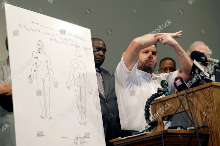 Shawn Parcells Forensic pathologist Shawn Parcells speaks during a news conference to share preliminary results of a second autopsy done on Michael Brown, in St. Louis County, Mo. The independent autopsy shows 18-year-old Michael Brown was shot at least six times, and Parcells, who assisted former New York City chief medical examiner Dr. Michael Baden during the autopsy, said a graze wound on Brown's right arm could have occurred in several ways
