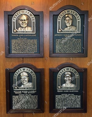 Plaques for 2014 Boston Red Sox Hall of Fame inductees hang at Fenway Park in Boston. Clockwise from top left are plaques honoring broadcaster Joe Castiglione, shortstop Nomar Garciaparra, pitcher Pedro Martinez and pitcher Roger Clemens. The four men will be honored before Thurday night's game against the Houston Astros