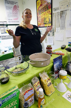 Melissa Fitzgerald discusses how to prepare a cannabis-infused dipping sauce during a cooking class at the New England Grass Roots Institute in Quincy, Mass. Some pot users turn to edibles because they don't like to inhale or smell the smoke, or just want variety or a longer lasting, more intense high