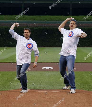 Mike Greenberg, Mike Golic Sports radio personalities Mike Greenberg, left, and Mike Golic throw out a ceremonial first pitch before a baseball game between the Chicago Cubs and the Colorado Rockies, in Chicago