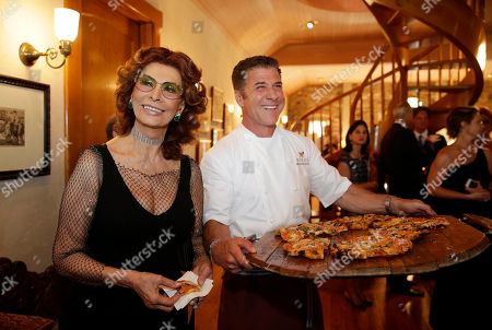 """Stock Image of Sophia Loren, Michael Chiarello Sophia Loren smiles after sampling pizza made by chef Michael Chiarello before the start of """"Bella Italia! a tribute to Sophia Loren"""" at the Far Niente winery, in Oakville, Calif. Loren turns 80 in September. The event is part of the Napa Valley Festival del Sole, a 10-day summer festival of music, theater and dance with the region's wine and cuisine"""