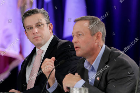 Stock Picture of Alejandro Garcia Padilla, Martin O Malley Puerto Rico Gov. Alejandro Garcia-Padilla, left, listens as Maryland Gov. Martin O'Malley speaks during a meeting dealing with healthcare at the Southern Governors' Association convention in Little Rock, Ark
