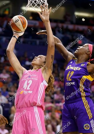 Stock Photo of Jantel Lavender, Brittney Griner Phoenix Mercury's Brittney Griner (42) gets off a shot as Los Angeles Sparks's Jantel Lavender (42) defends during the first half of a basketball game, in Phoenix