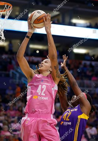 Stock Image of Brittney Griner, Jantel Lavender Phoenix Mercury's Brittney Griner, left, gets off a shot as she gets past Los Angeles Sparks's Jantel Lavender, right, during the first half of a basketball game, in Phoenix