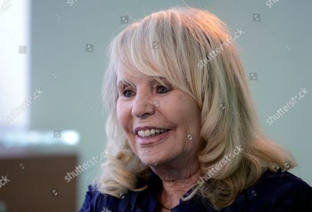 Shelly Sterling Shelly Sterling, wife of former Los Angeles Clippers owner Donald Sterling, smiles during an interview in Los Angeles. Shelly Sterling is going after the $2.5 million in real estate and cars her husband lavished on his girlfriend, V. Stiviano, in a trial scheduled to begin, in Los Angeles Superior Court