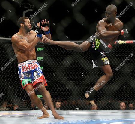 Uriah Hall, Thiago Santos Uriah Hall, right, kicks Thiago Santos during their middleweight mixed martial arts bout at UFC 175, in Las Vegas