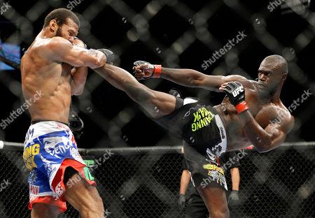 Uriah Hall kicks Thiago Santos during their middleweight mixed martial arts bout at UFC 175, in Las Vegas
