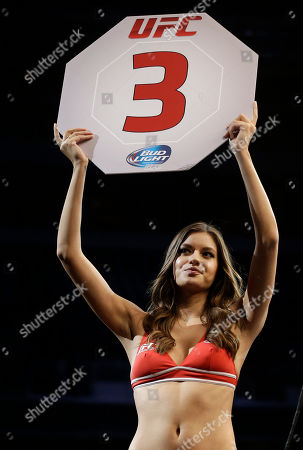 UFC octagon girl Vanessa Hanson is shown during a mixed martial arts bout at a UFC on Fox event in San Jose, Calif
