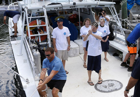 Stock Image of Fabien Cousteau Fabien Cousteau, standing by a hatch, clasps his hands as he returns to the dock after 31 days undersea in the Aquarius Reef Base, in Islamorada, in the Florida Keys. Cousteau and his team of filmmakers and scientists dove June 1 to study the effects of climate change and pollution on a nearby coral reef
