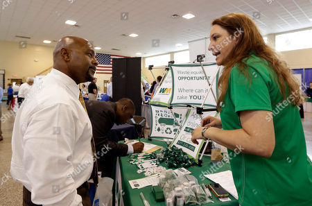 Job seeker U.S. Air Force veteran Jimmie Walker, left, listens to job recruiter Desiree Akel, at a Hiring Fair For Veterans in Fort Lauderdale, Fla. The Labor Department reports the number of people who applied for unemployment benefits last week on Thursday, July 17, 2014