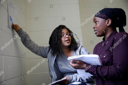 Paola Francisco, 16, left and Salma Bah, 16, work together on a math problem in an Upward Bound program that serves as a pathway to college for students from low-income families, in New York. National Upward Bound alumni include Oprah Winfrey, actresses Viola Davis and Angela Bassett, ABC News correspondent John Quinones, and Democratic political strategist Donna Brazile