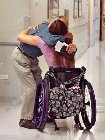 Amy Van Dyken-Rouen Olympic swimmer Amy Van Dyken-Rouen hugs Craig Hospital Director of Phychology Dr. Lester Butt as she leaves Craig Hospital in Englewood, Colo., . Van Dyken-Rouen was left paralyzed just below the waist in an all-terrain vehicle crash on June 6 in Arizona