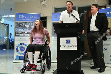 Amy Van Dyken-Rouen Olympic swimmer Amy Van Dyken-Rouen, left, sits in her wheelchair, beside her husband Tom Rouen, center, and Craig Hospital CEO Mike Fordyce, as all three talk with members of the media on the day of her discharge from Craig Hospital, in Englewood, Colo., . Van Dyken-Rouen was left paralyzed just below the waist in an all-terrain vehicle crash on June 6 in Arizona