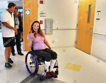Amy Van Dyken-Rouen Amy Van Dyken-Rouen gestures as she leaves Craig Hospital with her husband, Tom Rouen, left, in Englewood, Colo. Van Dyken-Rouen was left paralyzed just below the waist in an all-terrain vehicle crash. Her occasional updates on social media have been upbeat and filled mostly with good news. She is excited to face the challenge of learning how to live without use of her legs. Her enthusiasm is not an act