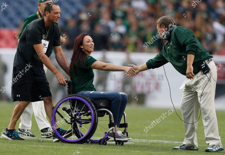 Jim McElwain, Amy Van Dyken Olympic gold-medal swimmer Amy Van Dyken-Rouen, center, greets Colorado State coach Jim McElwain, right, as she is wheeled off the field after taking part in the coin toss for an NCAA college football game between Colorado and Colorado State in Denver. The six-time Olympic gold medalist swimmer is going through rehab after severing her spine in an all-terrain vehicle accident last June that left her paralyzed from the waist down. She is to work as a broadcaster Friday at a Pac-12 swim meet