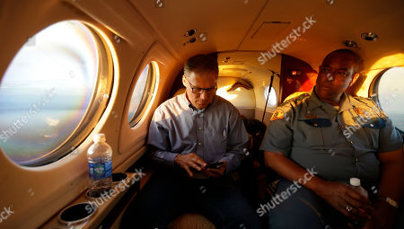 Jay Inslee, John Batiste As the sun sets, Washington Gov. Jay Inslee, left, and Washington State Patrol Chief John Batiste, right, view smoke from the Chiwaukum Creek Fire near Leavenworth, Wash., from the air, . The officials were returning form a day-long tour of areas affected by wildfires in Washington state