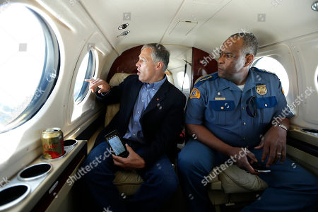 Jay Inslee Washington Gov. Jay Inslee, left, and Washington State Patrol Chief John Batiste, right, view the Chiwaukum Creek Fire near Leavenworth, Wash., from the air
