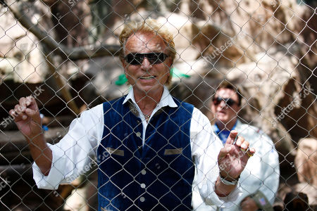 Siegfried Fischbacher speaks with the media during an event to welcome three white lion cubs to Siegfried & Roy's Secret Garden and Dolphin Habitat, in Las Vegas. The three white lion cubs, born in South Africa, are scheduled to be available for public viewing Friday
