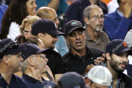 Chris Chelios, Kid Rock Musician Kid Rock, center left, and former Detroit Red Wings Chris Chelios are seen during the fifth inning of a baseball game between the Detroit Tigers and the Chicago White Sox, in Detroit