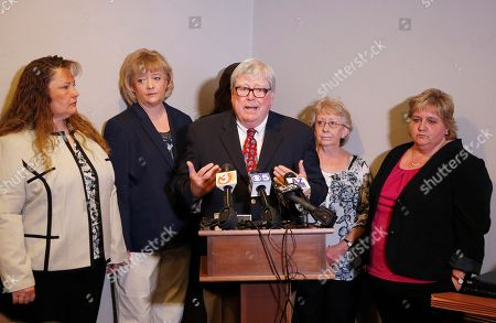 Deborah Harper, Tracey Everitt, Janet Sabol, Michelle Parker, Jana Leineweber, Terry Woods Joined by their lawyer Terrence Woods, middle, five senior Arizona child welfare employees, Michelle Parker, left, Tracey Everitt, second from left, Jana Leineweber, obscured behind Woods, Janet Sabol, second from right, and Deborah Harper, right, who were fired last month for their role in the closure of more than 6,500 Arizona child abuse and neglect cases explain and defend their actions at a news conference, in Phoenix