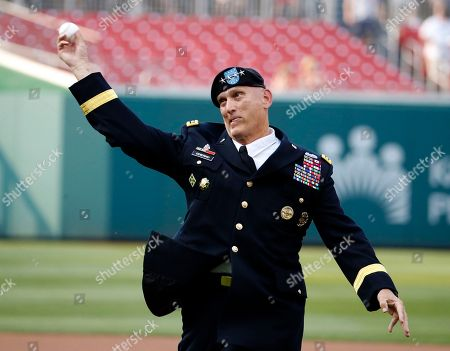 Stock Image of Raymond T. Odierno U.S. Army Gen. Raymond T. Odierno, Chief of Staff of the Army, throws out a ceremonial first pitch before an interleague baseball game between the Washington Nationals and the Houston Astros at Nationals Park, in Washington