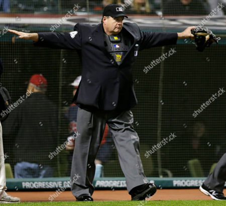 Stock Photo of Jerry Layne Home plate umpire Jerry Layne gestures after a review that Oakland Athletics' Josh Donaldson had a triple off Cleveland Indians relief pitcher Bryan Shaw in the seventh inning of a baseball game, in Cleveland. Coco Crisp and Alberto Callaspo scored