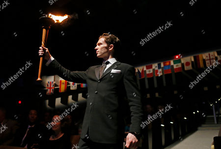 """Joseph Phillips Joseph Phillips, the 2002 USA IBC Junior Gold Medalist brings the lit torch for the lighting of the USA IBC Flame through Thalia Mara Hall during the 2014 USA International Ballet Competition opening ceremony in Jackson, Miss., . Dancers from around the world are competing in the USA International Ballet Competition, held every four years. The two-weeks of competition has 97 competitors vying for medals, scholarships, cash awards and company contracts in the """"Olympic-style"""" competition"""