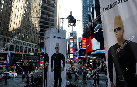 """Stock Photo of Bello Nock Bello Nock, a seventh-generation circus performer, in an attempt to set a record for """"The Longest Continuous Interview on a Wire,"""" sits 27 feet above New York's Times Square, . This eight hour stunt kicks off the """"Summer of Bello"""" which will culminate on Aug. 30, when he will attempt to perform fifteen death defying stunts in Las Vegas"""