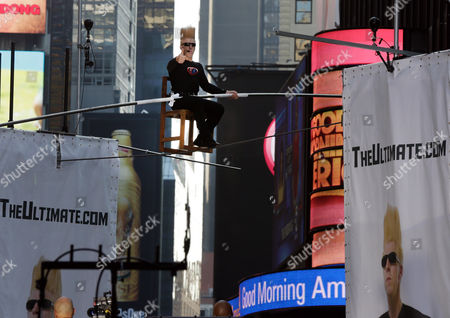 """Bello Nock Bello Nock, a seventh-generation circus performer, in an attempt to set a record for """"The Longest Continuous Interview on a Wire,"""" sits 27 feet above New York's Times Square, . This eight hour stunt kicks off the """"Summer of Bello"""" which will culminate on Aug. 30, when he will attempt to perform fifteen death defying stunts in Las Vegas"""