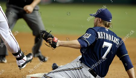 Mark Reynolds, David Peralta Milwaukee Brewers' Mark Reynolds (7) beats Arizona Diamondbacks' David Peralta to the first base bag, after Peralta's swinging third strike was dropped by Brewers' catcher Martin Maldonado during the ninth inning of a baseball game, in Phoenix. The Brewers defeated the Diamondbacks 9-3