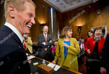 """Valerie Harper, Bill Nelson, Susan Collins, Harold Varmus Committee Chairman Sen. Bill Nelson, D-Fla., left, and ranking member Sen. Susan Collins, R-Maine, right, react to actress and cancer survivor Valerie Harper's comment to Nelson that he still looks like """"a little cute beach boy"""" as they exchange greetings before the start of a Senate Special Committee on Aging hearing to examine the fight against cancer, focusing on challenges, progress, and promise, on Capitol Hill in Washington, . Standing back second from left is National Institutes of Health's National Cancer Institute Director Harold Varmus"""