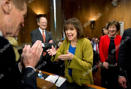 """Valerie Harper, Bill Nelson, Susan Collins, Harold Varmus Committee Chairman Sen. Bill Nelson, D-Fla., left, and actress and cancer survivor Valerie Harper exchange greetings before the start of a Senate Special Committee on Aging hearing to examine the fight against cancer on Capitol Hill in Washington, . Ranking member Sen. Susan Collins, R-Maine, right, and National Institutes of Health's National Cancer Institute Director Harold Varmus, back left, watch. Harper told Sen. Nelson that he still looks like """"a little cute beach boy"""