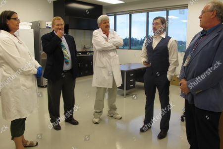 Stock Picture of Researchers and company officials at Avianax are shown in the company's lab at the University of North Dakota in Grand Forks, N.D., . They are from left, Bernadette Meberg, chief technician; Dr. David Bradley, UND medical school's chair of microbiology and immunization; Jeremy Vrchota, Avianax sales director and regulatory liaison; and Richard Glynn, the company's chief operating officer. Grand Forks-based Avianax is testing its cure for the canine parvovirus in seven states around the country. Results have shown a 90 percent rate among nearly 50 puppies that have been treated