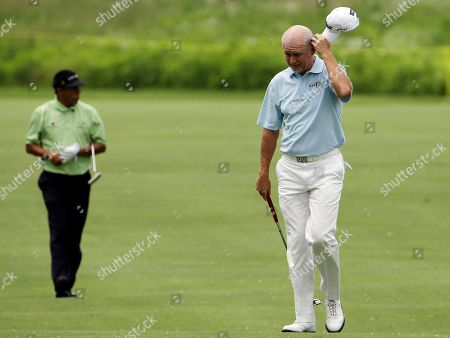 Stock Image of Roger Chapman Roger Chapman reacts as he walks on the first hole after hitting his second shot during the second round of the Encompass Championship golf tournament in Glenview, Ill