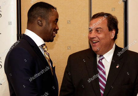 Chris Christie, Curtis Martin New Jersey Gov. Chris Christie, right, chats with former New York Jets football player Curtis Martin at a reception before the 73rd Annual Father of the Year Awards benefit luncheon, in New York. They are both honorees at the event