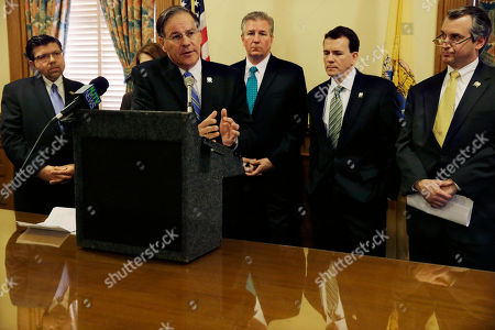 Jon M. Bramnick, Anthony M. Bucco, Scott T Rumana, Declan J. O'Scanlon, David P. Rible As New Jersey Assemblymen Anthony M. Bucco, left, R-Randolph, Scott T Rumana, right, R-Wayne, Declan J. O'Scanlon, second right, R-Red Bank, and David P. Rible, third right, R- Wall, listen as Assemblyman Jon M. Bramnick, R-Westfield, the top Republican in the Assembly tells a gathering in Trenton, N.J., that the Legislature's investigation into politically motivated traffic jams at the George Washington Bridge should be suspended. Minority Leader Jon Bramnick said the bipartisan panel should suspend hearings until the U.S. Attorney concludes his criminal investigation. Federal authorities and the legislative panel are trying to determine who ordered approach lanes to the bridge shut last September. That caused gridlock in Fort Lee, the town at the base of the busy span linking New Jersey and New York