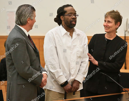 Stock Picture of Robert Hill, center, stands with his lawyers Harold Ferguson, left, and Sharon Katz, right, as Justice Neil Firetog declared him exonerated in Brooklyn Supreme Court, in New York. Prosecutors in Brooklyn asked to throw out the decades-old convictions of three half-brothers who were investigated by homicide detective Louis Scarcella, whose tactics have come into question. The defendants, Hill, Alvena Jennette and Darryl Austin became the first people connected to the detective to be exonerated
