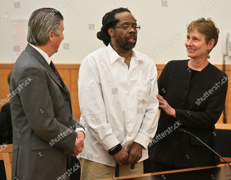 Robert Hill, center, stands with his lawyers Harold Ferguson, left, and Sharon Katz, right, as Justice Neil Firetog declares Hill exonerated in Brooklyn Supreme Court, in the Brooklyn borough of New York. Prosecutors asked to throw out the decades-old convictions of three half-brothers who were investigated by homicide detective Louis Scarcella, whose tactics have come into question. The defendants, Hill, Alvena Jennette and Darryl Austin became the first people connected to the detective to be exonerated