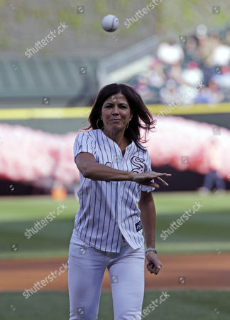 Stock Picture of Zoraida Sambolin NBC 5 News co-anchor & breast cancer survivor Zoraida Sambolin throws out a ceremonial first pitch before an interleague baseball game between the Chicago White Sox and the Arizona Diamondbacks in Chicago