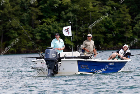 Jason Ulin, Sam Baker, John Mantovani Purple Heart recipient Sgt. Jason Ulin, left, of Savannah, Ga., fishes with Atlanta Falcons' offensive tackle Sam Baker, right, and fishing guide John Mantovani during the team's annual 'Fishing With the Falcons' event with wounded veterans, on Lake Lanier in Buford, Ga. The Falcons host the annual out outing to thank wounded veterans. Ulin served two tours in Afghanistan