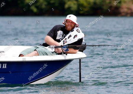 Atlanta Falcons' Sam Baker enjoys himself during the team's annual 'Fishing With the Falcons' event with wounded veterans . The Falcons host the annual out outing to thanks