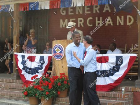 Stock Picture of Democratic candidate for lieutenant governor Bakari Sellers, left, and Democratic candidate for governor state Sen. Vincent Sheheen, right, hug after they are introduced at the Galivants Ferry Stump, in Galivants Ferry, S.C. Democratic candidates have been coming to the stump since the 1870s, but they are all underdogs this year in South Carolina