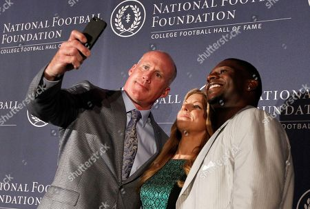 Bonnie Bernstein, Shane Conlan, Ladainian Tomlinson Former Penn State linebacker Shane Conlan, left, and former TCU tailback LaDainian Tomlinson, right, pose for selfie with event emcee Bonnie Bernstein, center, after Conlan and Tomlinson were introduced as 2014 inductees at a National Football Foundation College Football Hall Of Fame news conference, in Irving, Texas
