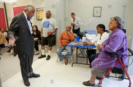 Rep. Charlie Rangel D-N.Y., left, speaks with constituents at a community center in Harlem, in New York. Rangel, who represents the 13th district, is being challenged in the upcoming primaries by New York state senator Adriano Espaillat. Rangel is running for his 23rd term