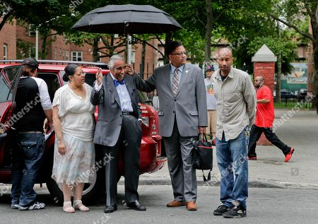 Rep. Charlie Rangel D-N.Y., second from left, waves to passing motorists upon arriving at a community center in Harlem to speak with constituents, in New York. Rangel is being challenged in the upcoming primaries by New York state senator Adriano Espaillat