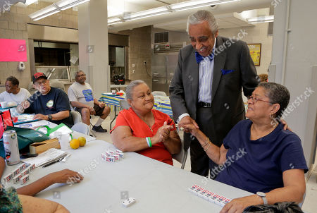 Charlie Rangel Rep. Charlie Rangel, D-N.Y., center, greets constituents at a community center in Harlem, in New York. Rangel, who represents the 13th district, is being challenged in the upcoming primaries by New York state senator Adriano Espaillat. Rangel is running for his 23rd term
