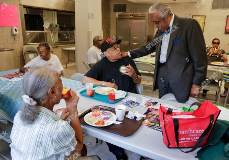 Rep. Charlie Rangel, right, speaks with constituents Arthur Franklin and Hattie Yarborough at a community center in Harlem, in New York. Rangel, who represents the 13th district, is being challenged in the upcoming primaries by New York state senator Adriano Espaillat. Rangel is running for his 23rd term