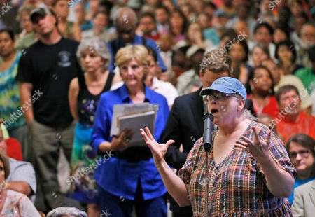 Mary B. Taylor Mary B. Taylor, of Lawrenceville, Va., asks a question during a presentation by federal officials involved in the placement of immigrant children at St Paul's College in Lawrenceville, Va., . The program is on hold pending comments from local residents