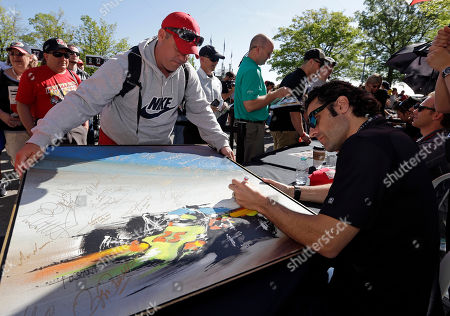 Dario Franchitti Pace car driver Dario Franchitti, of Scotland, signs a poster for Daniel Bingamon during an autograph session for fans before a drivers meeting for the Indianapolis 500 IndyCar auto race at the Indianapolis Motor Speedway in Indianapolis, . The 98th running of the Indianapolis 500 is Sunday
