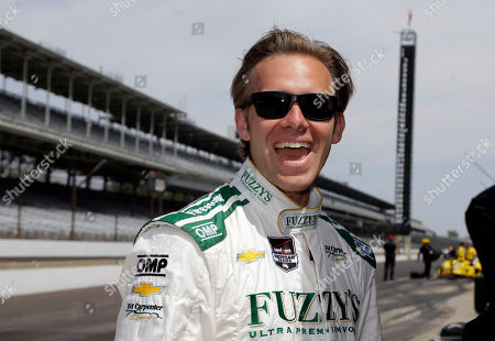 Ed Carpenter Pole-sitter Ed Carpenter laughs as he watches Dario Franchitti squeal the tires on the pace car as he pulled onto the track before the start of practice for the Indianapolis 500 IndyCar auto race at the Indianapolis Motor Speedway in Indianapolis